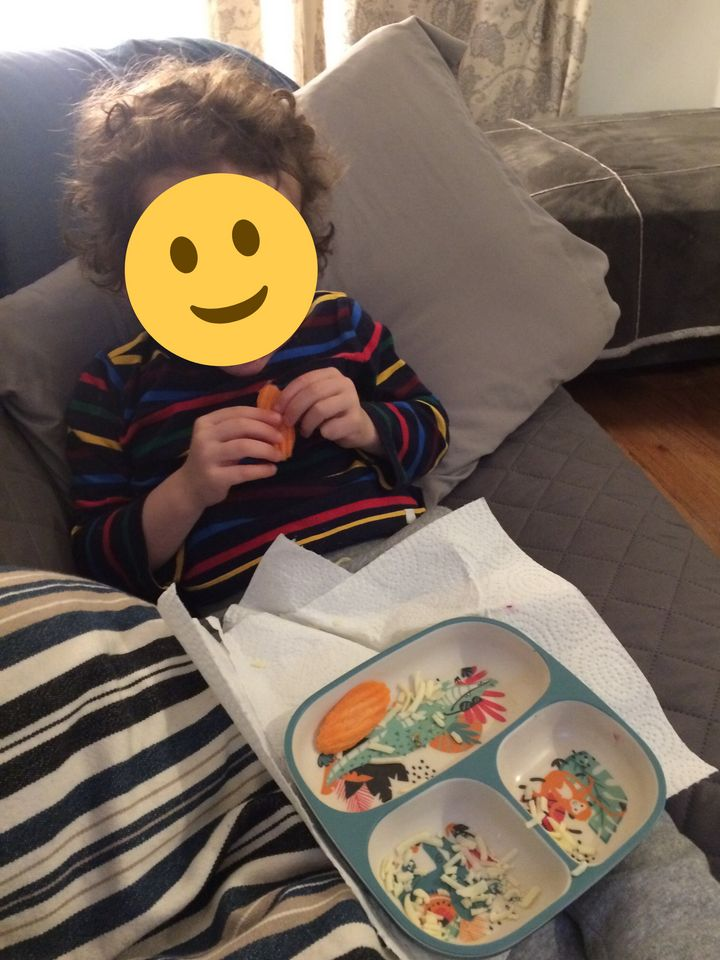 """Here's my kid proudly hoovering his """"special dinner"""" last night. Yes, we're eating dinner on the couch while watching """"Mighty Pups."""" No one said I'm winning any parenting awards."""