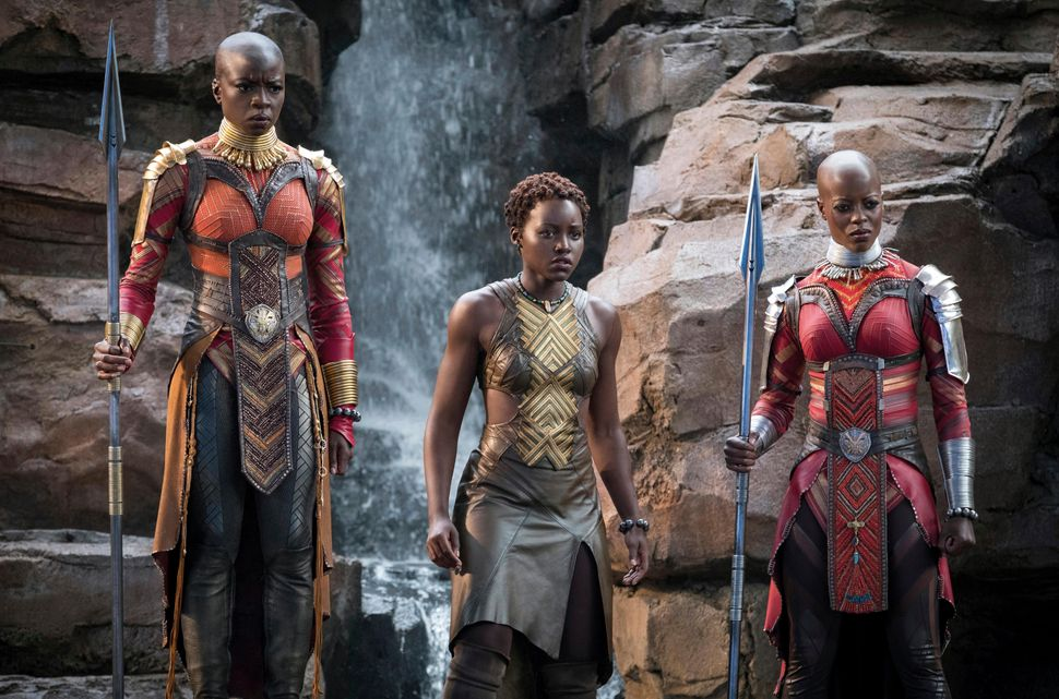 "Next to Nyong'o flanked by Danai Gurira, left, and Florence Kasumba in ""Black Panther."""