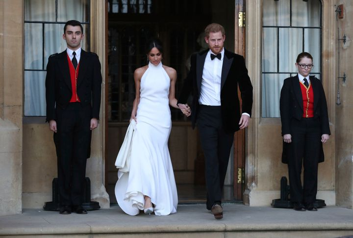 Meghan and Harry step out at their wedding reception.