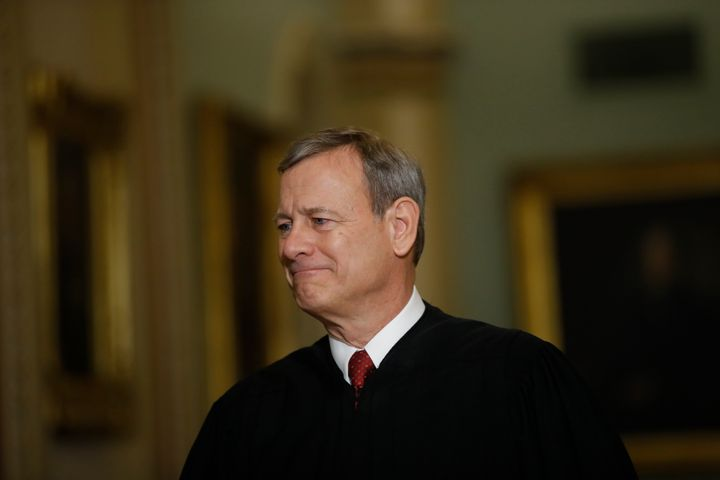Supreme Court Chief Justice John Roberts walks to the Senate chamber at the Capitol on Thursday.