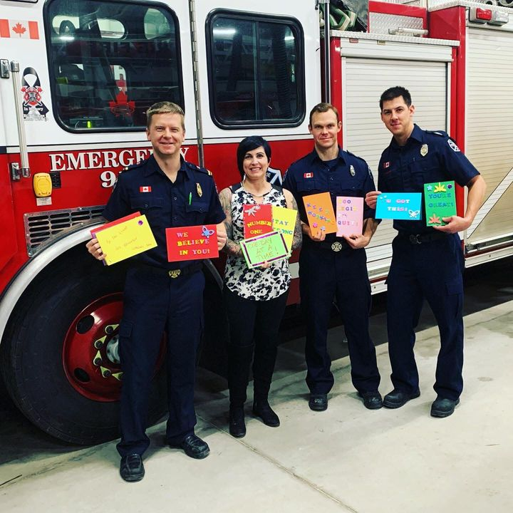Harris poses with some of the firefighters who made cards.