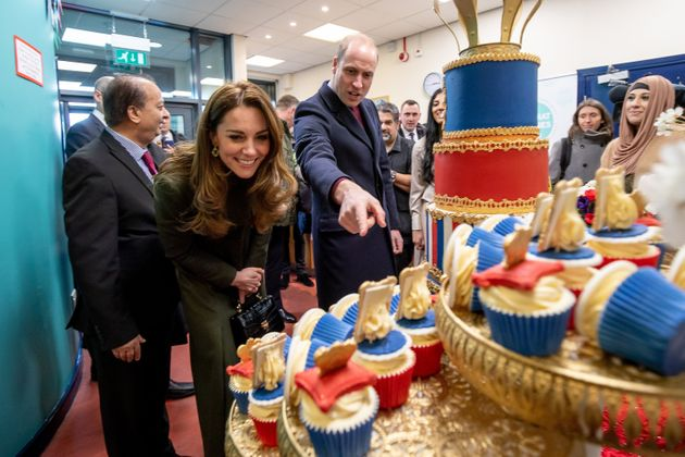 The Duke and Duchess of Cambridge inspect cakes as they visit the Khidmat Centre on Jan. 15 in Bradford.