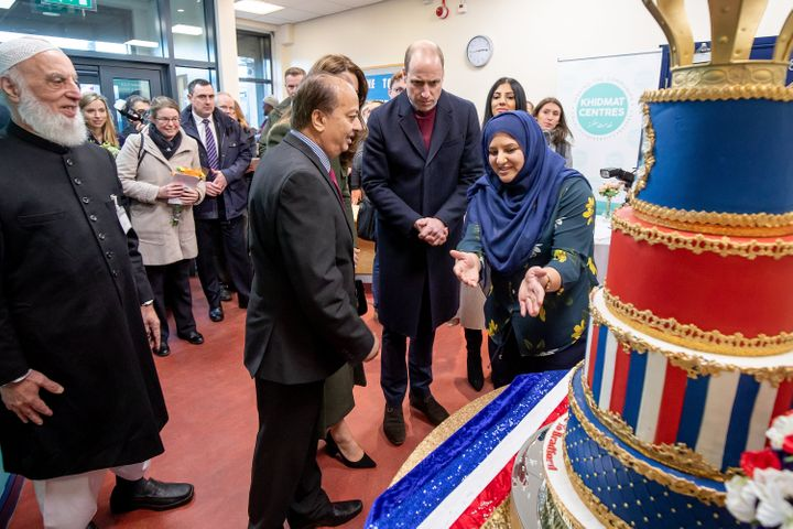 The Duke and Duchess of Cambridge inspect cakes as they visit the Khidmat Centre.