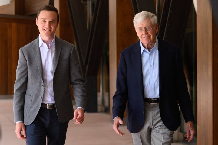 Brian Hooks (left), now CEO and chairman of the Koch network Stand Together, and Charles Koch attend an organizational gather