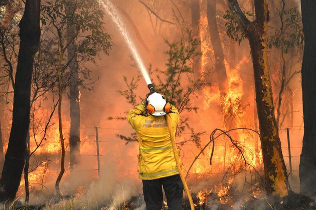 Back-burning is used to protect residential areas from encroaching bushfires in the Central Coast, about...