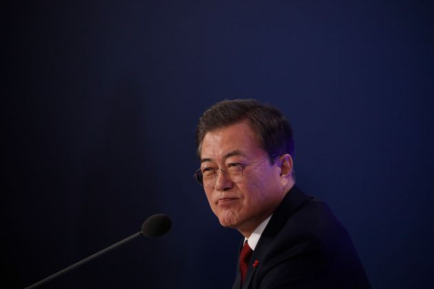 South Korean President Moon Jae-in speaks during his New Year press conference at the presidential Blue...