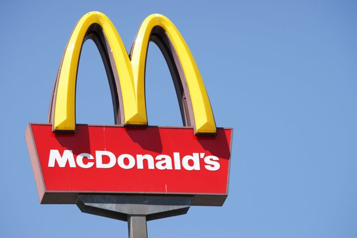 Ljubljana, Slovenia - September 3, 2011: Close-up of McDonalds outdoor sign with  typical rounded yellow M letter against cloudless blue sky. Sign is positioned on the left side of image.