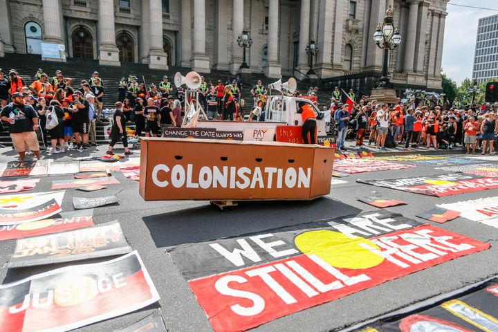 A mock coffin with 'Colonisation' written on it surrounded by placards out the front of Victorian Parliament house during a protest by Aboriginal rights activist on Australia Day in Melbourne, Australia 26 January 2018. Australia Day is named by some as Invasion Day due to the dispossession of Indigenous land and the arrival of the First Fleet's at Port Jackson, Sydney, in 1788.