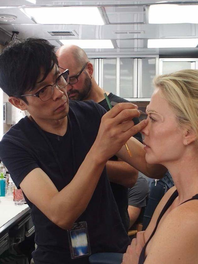 Kazu Hiro applying prosthetics to actor Charlize