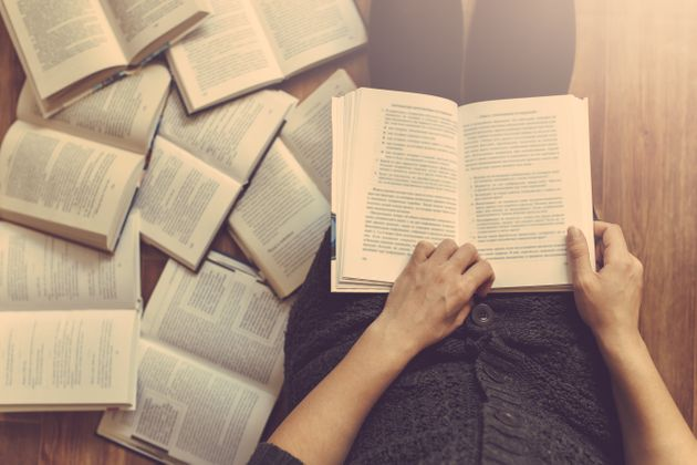 Woman reading a few books on the
