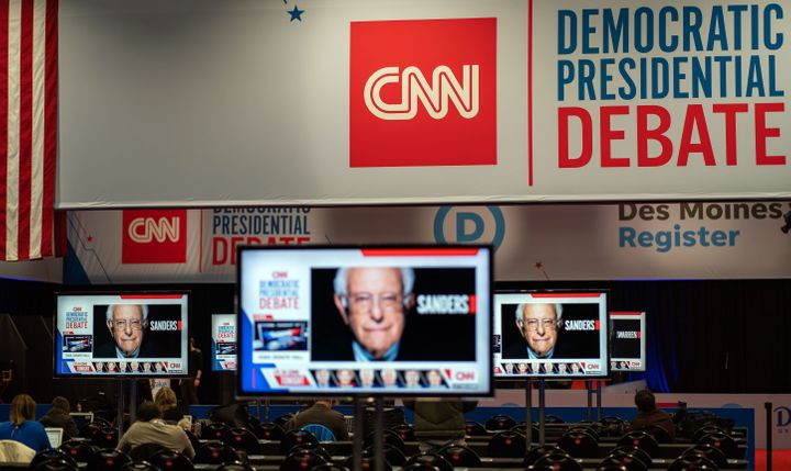 After a 15-year legal fight, CNN settled a dispute with former employees just before the latest Democratic debate.