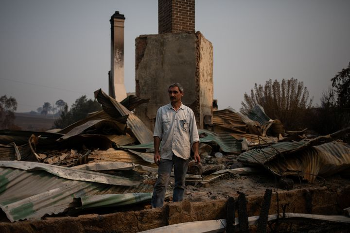 Thousands of people like Philippe Ravenel, pictured here, have lost their homes to the fires.