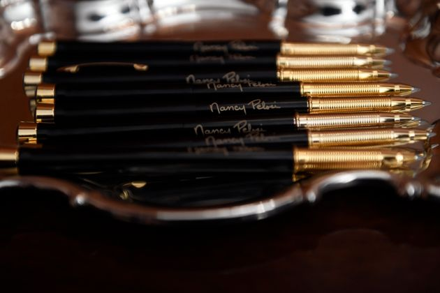 The pens that House Speaker Nancy Pelosi of Calif., will use to sign the resolution to transmit the two...
