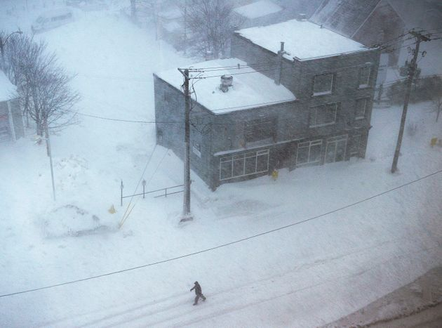The scene on New Gower Street in St. John's on Friday as a major winter storm batters Newfoundland where...