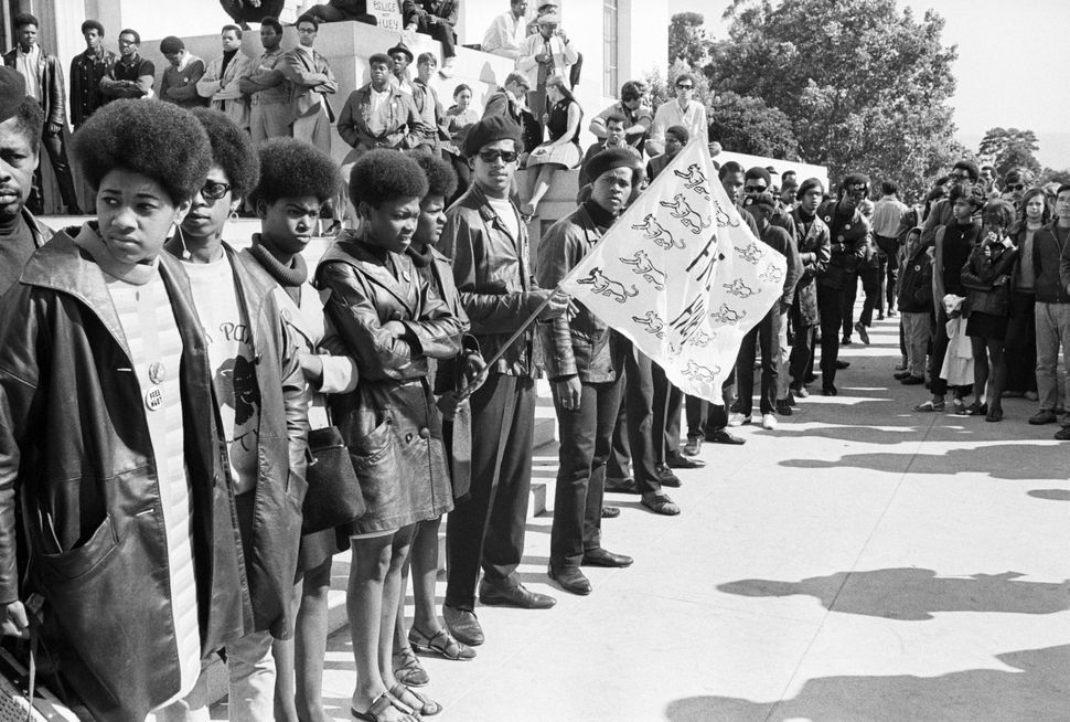 Black Panther Party members and sympathizers gathered outside the courthouse in Oakland during the 1968 trial in which party