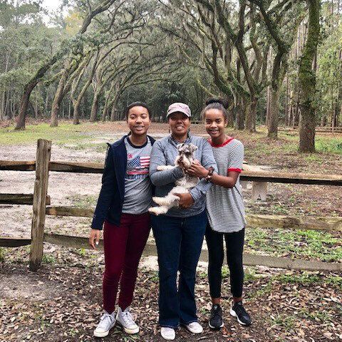 Chapman and her daughters Makayla (left) and Ashley (right), along with the family dog, Lucky, on vacation to Savannah, Ga. in November 2018.