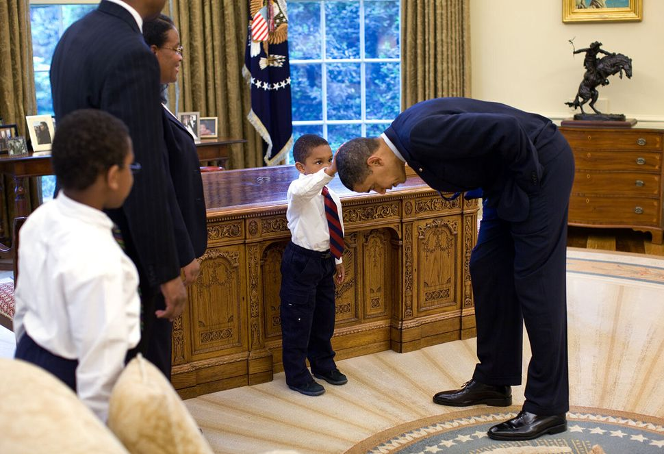 When a 5-year-old visiting the Oval Office in 2009 asked if he could touch President Barack Obama's hair to see if it felt th