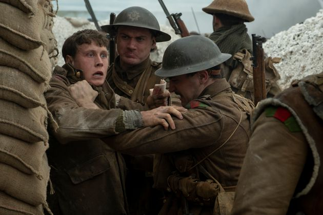 Schofield (George MacKay, left) with fellow soldiers in 1917, the new epic from Oscar®-winning filmmaker...
