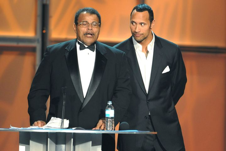 """Dwayne """"The Rock"""" Johnson inducting his father into theInternational Pro Wrestling Hall Of Fame in 2008"""