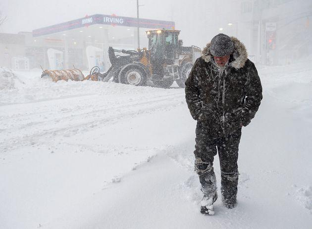 A pedestrian walks through heavy snow in St. John's on Jan. 17,