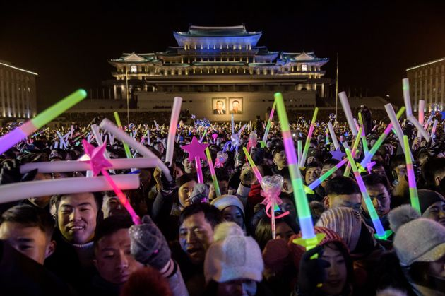 Spectators attend a New Year's Eve countdown event on Kim Il Sung square in Pyongyang on December 31,...
