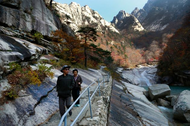 FILE - In this Oct. 23, 2018, file photo, local tourists walk on the trail at Mount Kumgang, known as...