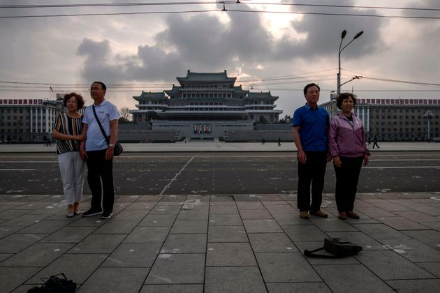 Tourists from China pose for photos on Kim Il Sung square in Pyongyang on June 19, 2019. (Photo by Ed...