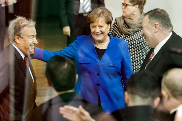 19 January 2020, Berlin: Federal Chancellor Angela Merkel (CDU) is standing between Antonio Guterres...