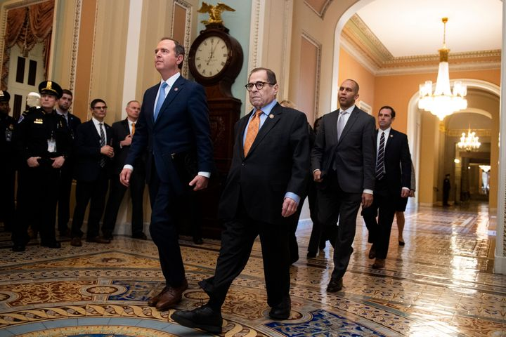 Impeachment managers arrive at the Senate to read the articles of impeachment on Thursday, led by Reps. Adam Schiff (D-Calif.