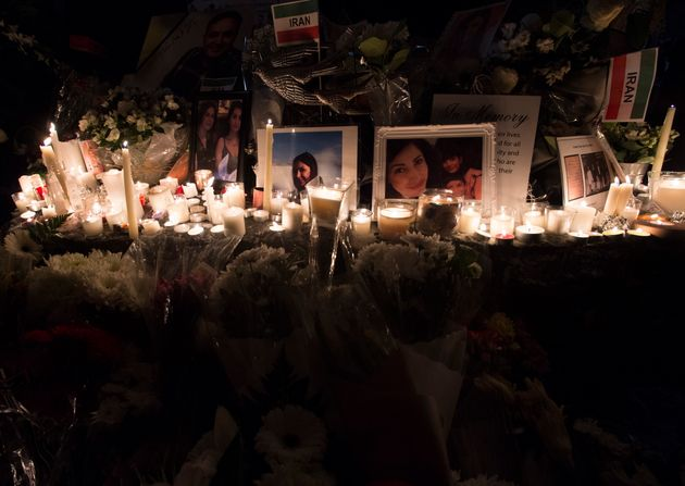 Mourners attend a memorial on Jan. 14, 2020 in North