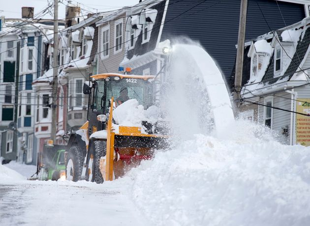 A snowblower widens the roadway in St. John's on