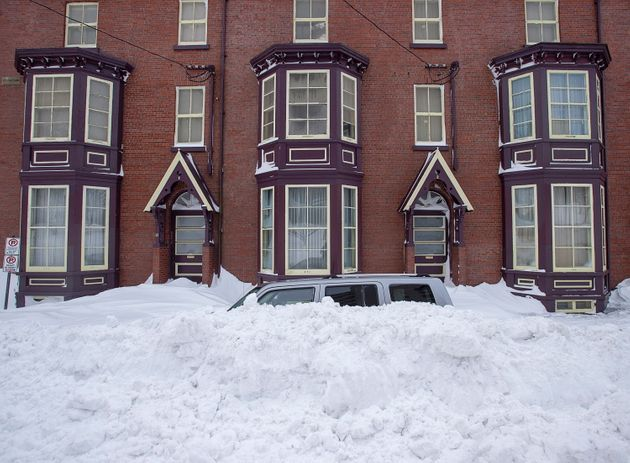 A vehicle is burried in snow in St. John's on