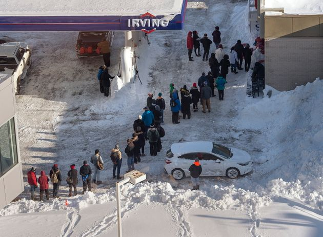 Customers line up outside a gas bar in St. John's on