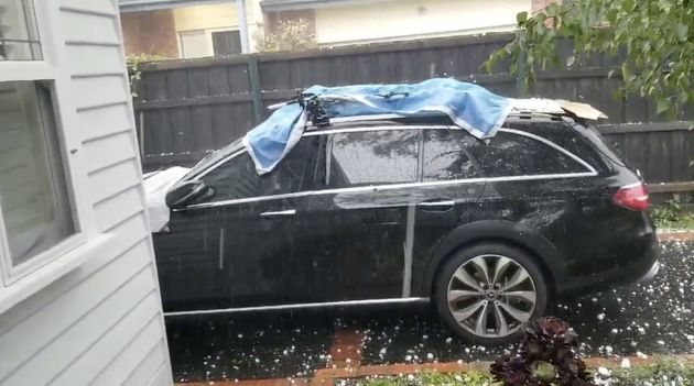 Hail stones fall on a car in Ashburton, Victoria, Australia January 19, 2020 in this picture grab obtained...