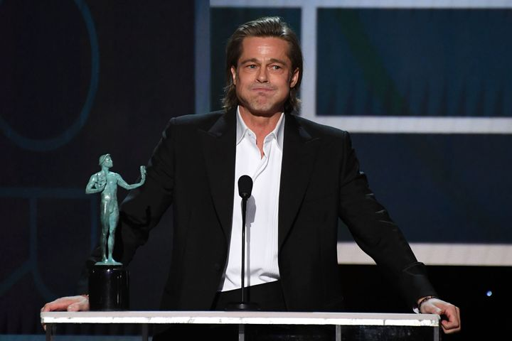Brad Pitt accepts the award for Outstanding Performance by a Male Actor in a Supporting Role in a Motion Picture at the 26th