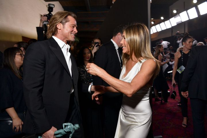 Brad Pitt and Jennifer Aniston greet each other at the Screen Actors Guild Awards on Sunday.
