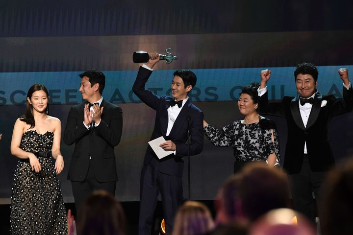 """Tthe cast of """"Parasite"""" accepts the award for Outstanding Performance by a Cast in a Motion Picture during the 26th Annual Sc"""