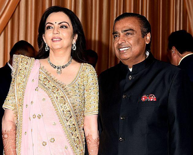 Businessman Mukesh Ambani (R) with wife Nita