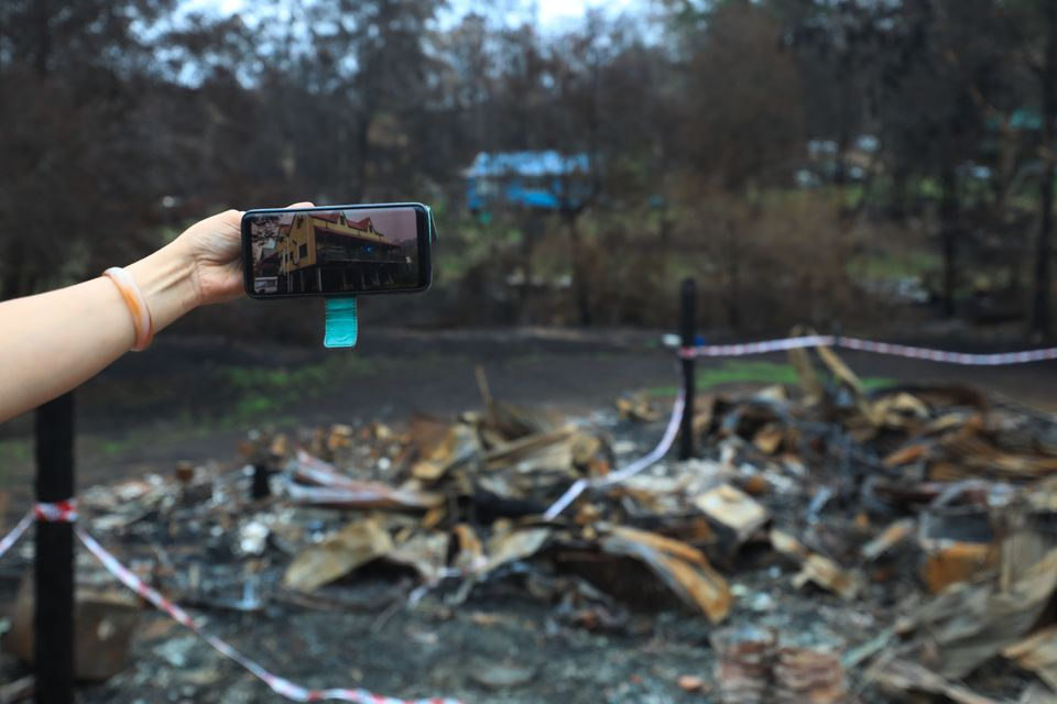 Photo taken on January 18 shows the property picture on its owner's phone taken before the bushfire and...