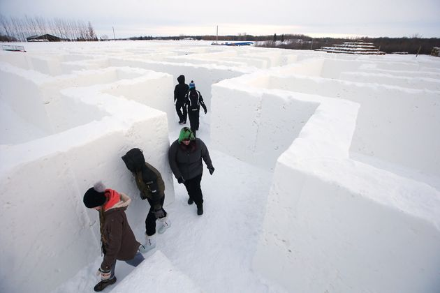 Visitors walk through a massive snow maze in Manitoba earlier this month. The maze set a Guinness World...