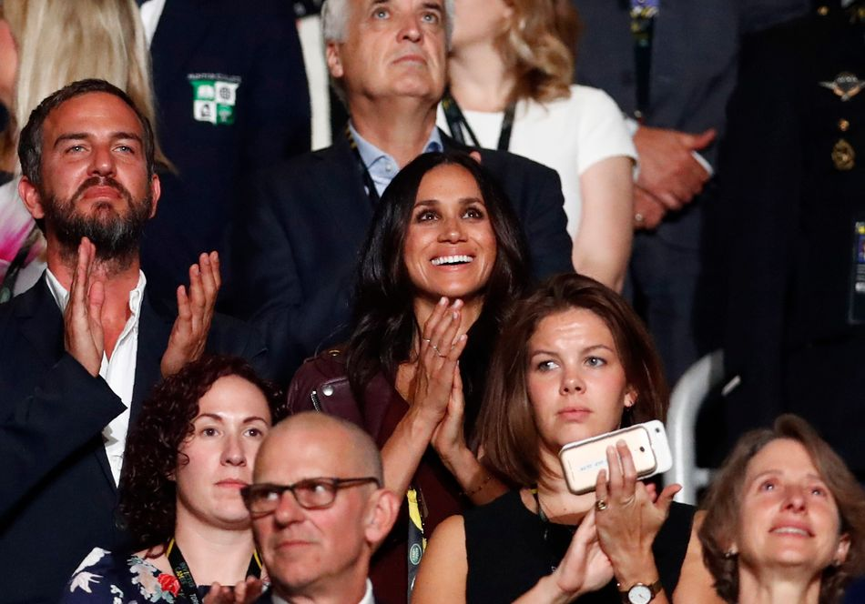 In our first glimpse of Meghan as Harry's girlfriend, we watched as she cheered on her boyfriend as he made a speech at the Invictus Games' opening ceremony in Toronto on Sept. 23, 2017.