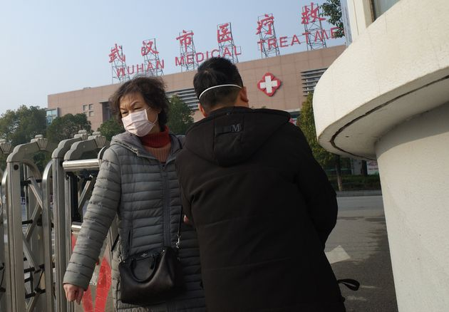A woma leaves the Wuhan Medical Treatment Centre on Jan. 12,
