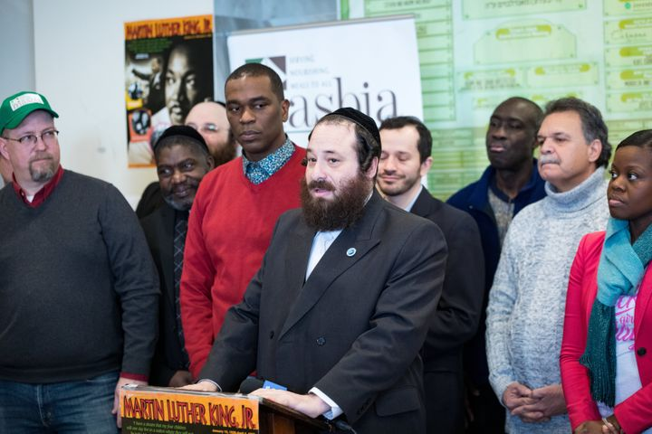 Rockland County legislator Aron Wieder, center, speaks at a Martin Luther King Day event in Brooklyn's Borough Park neighborh