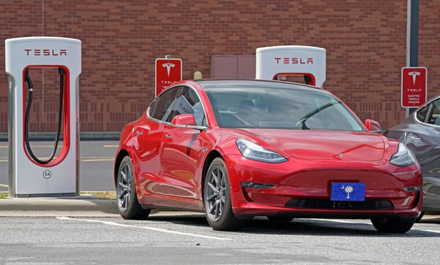 A Tesla vehicle is shown charging at a Tesla Supercharger site in Charlotte, N.C., Friday, July 19, 2019....