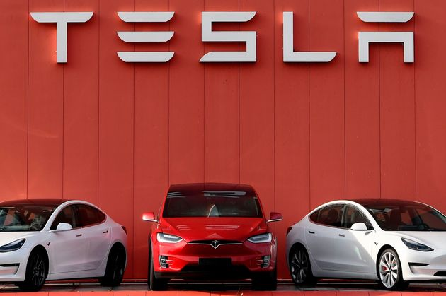 The logo marking the showroom and service center for the US automotive and energy company Tesla in Amsterdam...