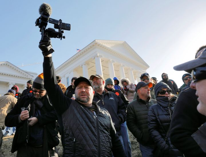 American radio host Alex Jones films the crowd inside the no-gun zone during a gun rights rally in front of the Virginia Stat