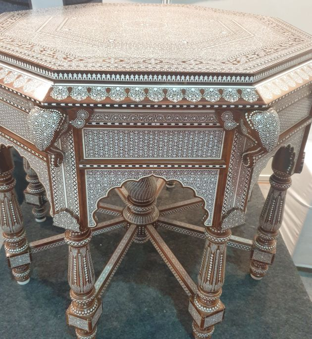 This table carved in Sheesham wood has over lakhs of depressions manually filled with acrylic material...