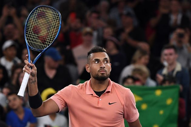Australia's Nick Kyrgios celebrates victory against Italy's Lorenzo Sonego during their men's singles...