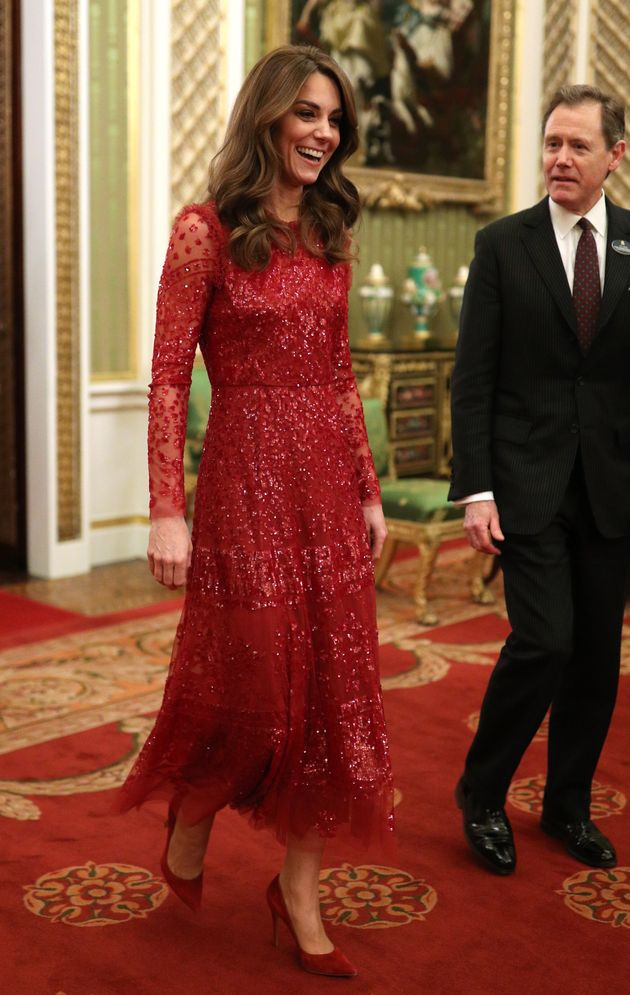 The Duchess of Cambridge walks through to the State Room with the master of the