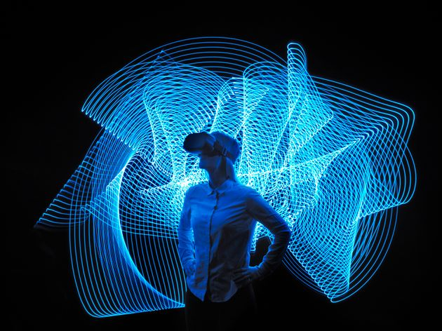 young woman with VR glasses, with lighttrace, interacting, virtual
